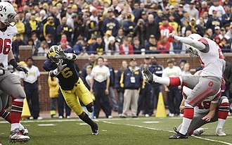 Donovan Warren - Warren attempts to block a kick for the 2009 Michigan Wolverines against Ohio State during the November 21 Michigan – Ohio State rivalry game.