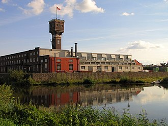 Oude IJsselstreek - Former DRU factory, with the characteristic water tower, at the river Oude IJssel
