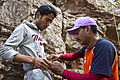 29RCCMAK - Trainer helping trainee climber to fasten a knot.jpg