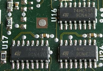 7400-series integrated circuits - Surface-mount 74HC595 shift registers on a PCB. This 74HC variant of the 74595 uses CMOS signalling voltage levels while the 74HCT595 variant uses TTL signalling levels.