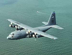 86th Operations Group - C-130E Hercules of the 86th AW Flying over the Normandy beachhead