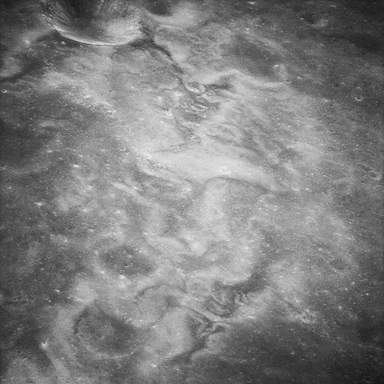 High-albedo swirls within unnamed crater east of Firsov