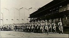 A group of soldiers marching in column of route