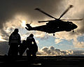 A Merlin of 824 Naval Air Squadron carrying out a high-line transfer MOD 45147618.jpg