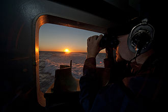 Watchstanding - A Sailor stands lookout watch aboard USS George H.W. Bush.