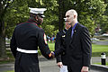 A U.S. Marine first sergeant, left, greets honorary Marine Daran Wankum during a wreath laying ceremony at the Marine Corps War Memorial in Arlington, Va, June 13, 2013 130613-M-KS211-002.jpg
