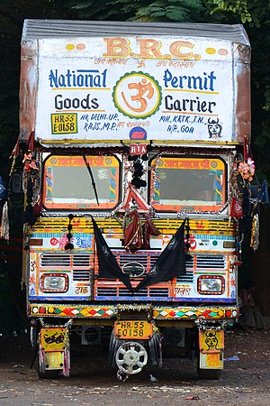 Nazar battu - A decorated truck in India, showing a black jutti and nazar battu motifs.