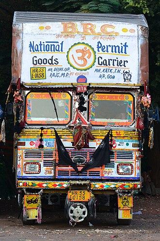 Nazar battu - A decorated truck in India, showing a black jutti and nazar battu motifs.
