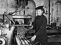 A member of the Women's Royal Naval Service (WRNS) working at a milling machine in the Royal Navy depot at Greenock, 22 March 1943. A15575.jpg