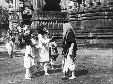 A shot from Raja Harishchandra (1913), the first film of Bollywood. A scene from film, Raja Harishchandra, 1913.jpg