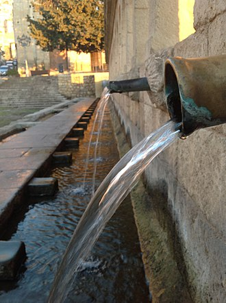 Water supply and sanitation in Italy - There are many public fountains in Italy that provide drinking water for free, such as the Granforte fountain in Liunforti (Sicily) shown here.