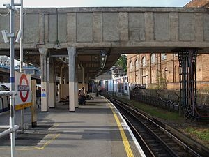 Acton Town tube station - Eastbound District line platform looking west with the remains of the branch on the right