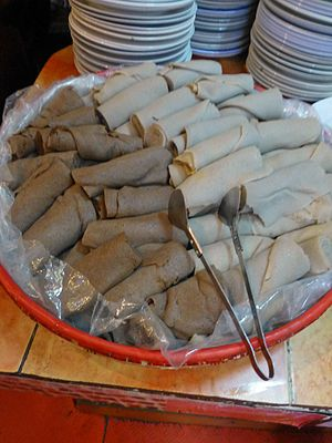 Injera - Different varieties of injera rolls (teff and wheat injera) at a restaurant in Addis Ababa.