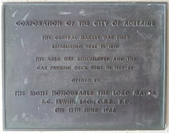 Adelaide Central Market - Photograph of a plaque to mark the opening of the redeveloped Adelaide Central Market Buildings by Lord Mayor James Irwin on 17 June 1966. This plaque is currently located at the Grote Street entrance to the markets.