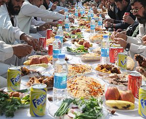 Afghan cuisine - Afghan men eating lunch in Kunar Province