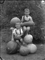Albert Percy Godber's grandsons, Colin and Norman Hartwig, with marrows and pumpkins, Silverstream ATLIB 306383.png
