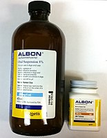 "On the left, a large amber bottle of labeled, ""Albon (sulfadimethoxine): Oral suspension 5%"". On the right, a bottle of Albon pills (125 mg, 200-count)"
