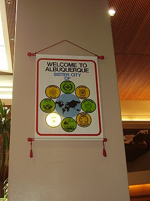 Albuquerque International Sunport - Banner inside the airport terminal listing Albuquerque's sister cities