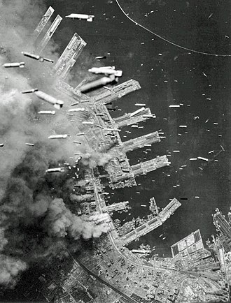 Bombing of Kobe in World War II - Incendiary bombs being dropped over the city of Kobe, 4 June 1945