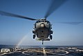 An MH-60R Sea Hawk helicopter lands on the flight deck of USS Chung-Hoon. (25234272225).jpg
