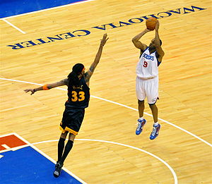 Andre Iguodala - Iguodala pulls up for a jumper while being defended by Mikki Moore.