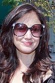 Andrea Riseborough, wearing sunglasses
