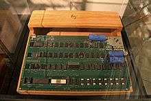 Apple I circuit board and wooden case with Woz sign, Computer History Museum.jpg