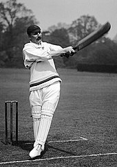 A posed black and white photo of MacLaren batting
