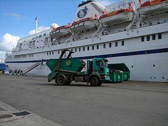 Classic International Cruises - The MS Athena unloading waste.