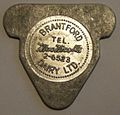BRANTFORD, ONTARIO, MacNICOLLS DAIRY c.1940 -ONE QUART MILK TOKEN a - Flickr - woody1778a.jpg