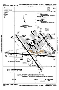 A map with a grid overlay showing the terminals runways and other structures of the airport.