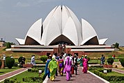 """Known in India as the """"Lotus Temple"""", the Bahá'í House of Worship, Delhi attracts 50 million visitors a year making it the most visited edifice in the world[citation needed]"""
