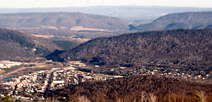 Water gap - View of water gaps cut by the Raystown Branch of the Juniata River through Evitts Mountain and Tussey Mountain, facing west from the summit of Kinton Knob, Wills Mountain, in Bedford County, Pennsylvania, with the town of Bedford in the foreground