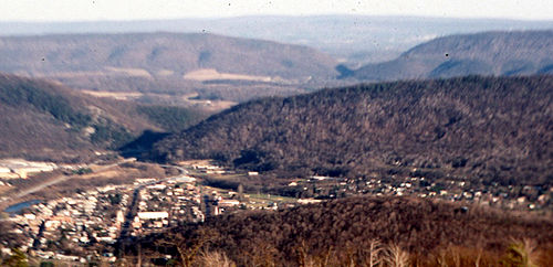 View of water gaps cut by the Raystown Branch of the Juniata River through Evitts Mountain and Tussey Mountain, facing west from the summit of Kinton Knob, Wills Mountain, in Bedford County, Pennsylvania, with the town of Bedford in the foreground Bedford-gaps.jpg