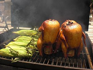 Beer can chicken - Beer can chicken being grilled with corn