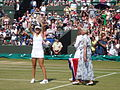 Belinda Bencic receives trophy from Ann Jones.jpg
