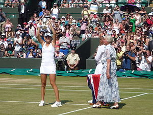 Belinda Bencic - Bencic lifting the 2013 Wimbledon juniors trophy