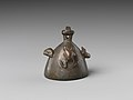 Bell with heads of a ram, a jackal, and a bovine wearing a yoke ending in uraei MET DP239487.jpg