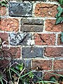 Benchmark on wall at west end of High Street - geograph.org.uk - 2191467.jpg