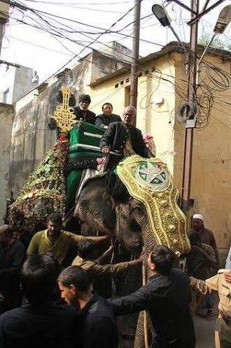 Muharram - Bibi ka alam procession on elephant in Dabirpura, Old City (Hyderabad, India).
