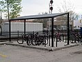 Bicycle shelter at Waltham station, April 2016.JPG