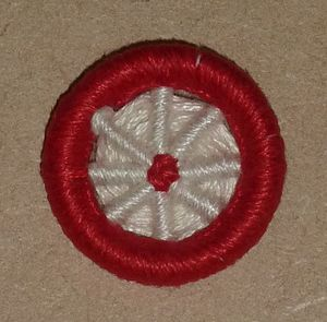 Dorset button - Image: Blandford cartwheel, red and white