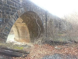 Bloomington Viaduct - Stone side of the viaduct. It's visible the reinforced concrete bridge added to the original stone one.