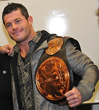 Matt Sydal - Bourne with the WWE Tag Team Championship belt in 2011