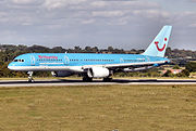 A Boeing 757-200 in Thomson colours and still displaying 'Britannia' titles and website address