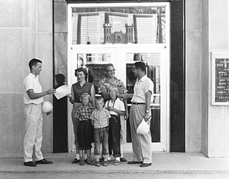 Tom Brokaw - Brokaw (left) greeting the 20,000th visitor to the Gavins Point Dam in 1958; Brokaw was a tour guide there