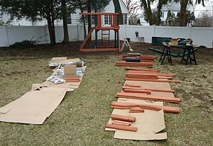 Backyard - A playground being built for a homeowner's back yard as part of a handyman project.