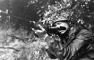"FG 42 - A German Fallschirmjäger poses with his early model FG 42 (Ausführung ""C"") in France, 1944."