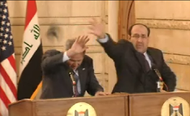 President George W. Bush ducking a thrown shoe, while Prime Minister Nouri al-Maliki attempts to catch it.