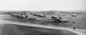 440th Operations Group - 5 June 1944 photograph of C-47s of the 95th and 98th Troop Carrier Squadrons at RAF Exeter with freshly applied black/white invasion stripes to aid in aircraft identification from the ground. There was insufficient space to park all the aircraft on the concrete, so many were parked on grass turf.